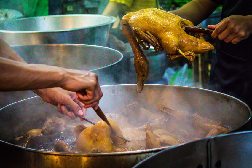 Steamed duck Steamed Duck Adult Day Food Food And Drink Freshness Holding Human Body Part Human Hand Men Occupation One Person Outdoors People Preparation  Preparing Food Real People Thai Food