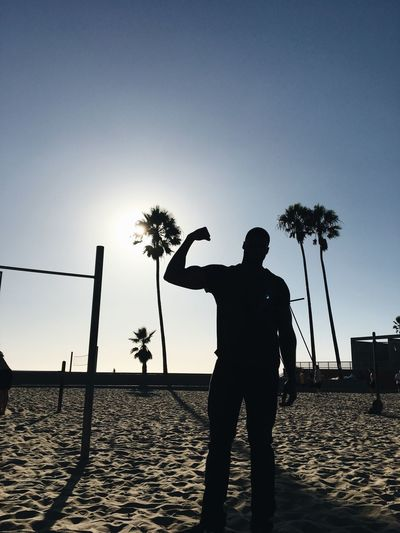 Beach Silhouette Sand Palm Tree Standing One Person Real People Men Tree Vacations Outdoors Leisure Activity Full Length Sky Lifestyles Nature One Man Only Clear Sky One Young Man Only Day Venice