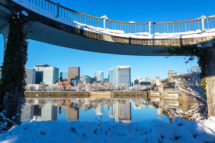 View of downtown Portland, Oregon after a winter storm Architecture Bridges City Cityscape Downtown Ice Mirror Oregon Pacific Portland Reflection Willamette River  Winter Bridge Cold Colorful Conventioncenter Infrastructure Morrison Northwest Park River Snow Urban Waterfront