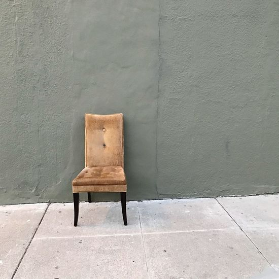 Chair On The Sidewalk EyeEm Selects Seat Chair Wall - Building Feature Architecture No People Footpath