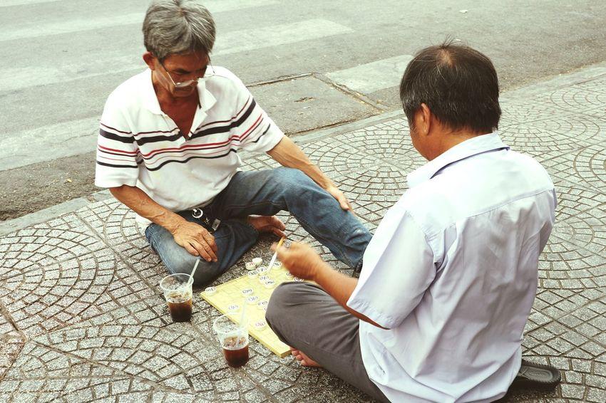 They were playing chess on the street in Saigon, Viet Nam.Vstreetlife Streetphotography Saigon Saigonese Chess Hot Day Lifestyle Lifestyle Photography