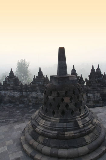Borobudur Temple with the mysteries forest surrounding during sunrise, Yogyakarta, Indonesia Yogyakarta Ancient Ancient Civilization Architecture Belief Borobudur Building Building Exterior Built Structure Fog Forest History No People Place Of Worship Religion Sky Spirituality Stone Material The Past Tourism Travel Travel Destinations