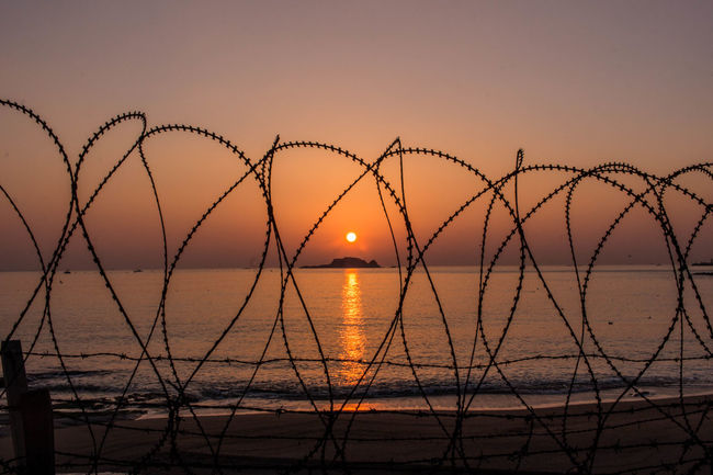 Barbed Wire Creativity Fence Happynewyear Military Area No People Orange Outdoors Photography Protection Razor Wire Safety Security Sky Sunrise Sunset