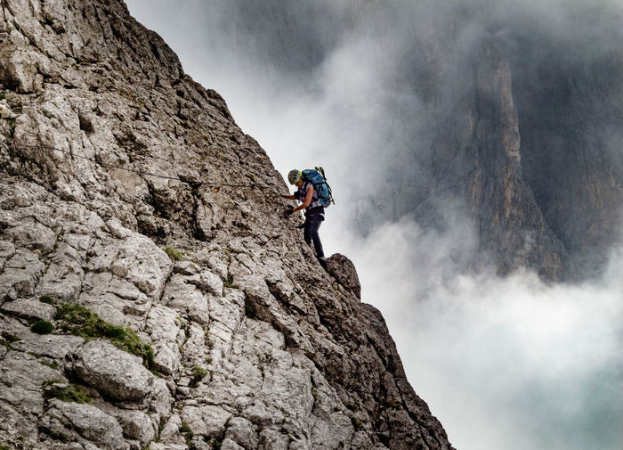 Dolomites, Italy Woman Adult Adventure Challenge Cliff Climbing Conquering Adversity Courage Danger Day Extreme Sports Leisure Activity Lifestyles Low Angle View Mountain Nature One Person Outdoors Real People RISK Rock - Object Rock Climbing Skill  Sport