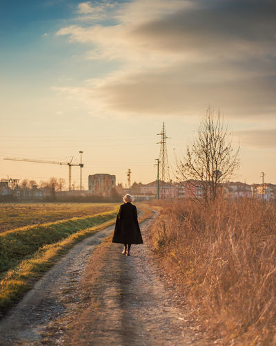 Back portrait of girl walking in the countryside at sunset Autumn End Of The Day Road Winter Woman Countryside Fall Future Girl Golden Hour Lifestyles Nature One Person Outdoors Real People Rear View Rural Scene Sky Sunset Sunsets Walking