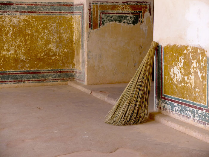 Broom Against Weathered Wall At Amber Fort