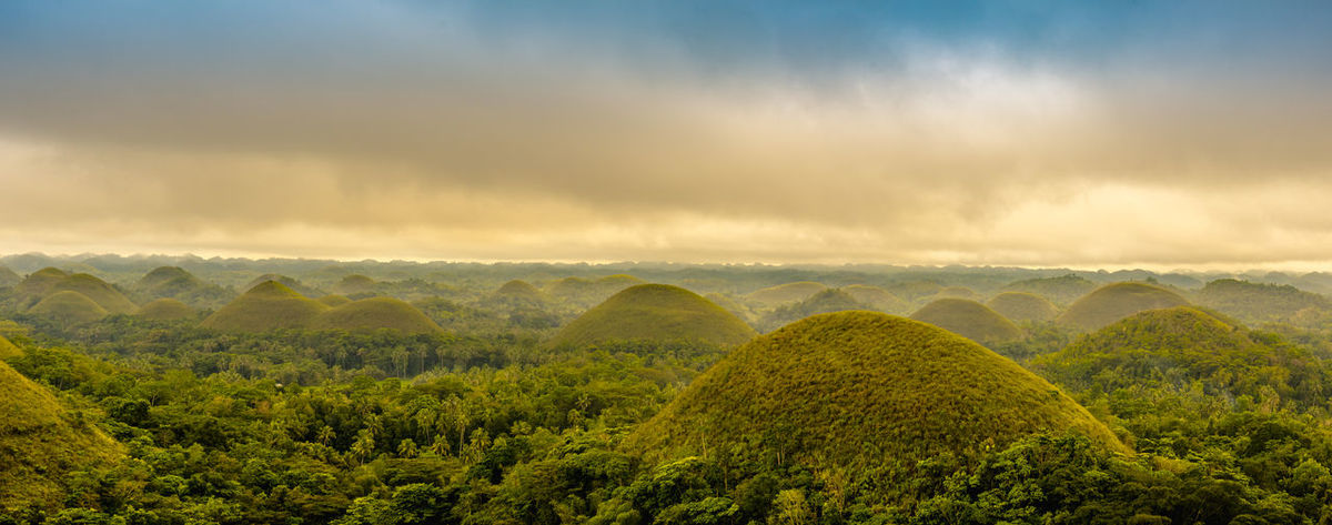 Scenic view of the UNESCO site of the Chocolate Hills in Bohol, Philippines Astronomy Beautiful Chocolate Hills Bohol Philippines Close-up Clouds Clouds And Sky Cloudy Day Colorful Hills Landscape Nature No People Philippines Shades Sky Sunset UNESCO World Heritage Site