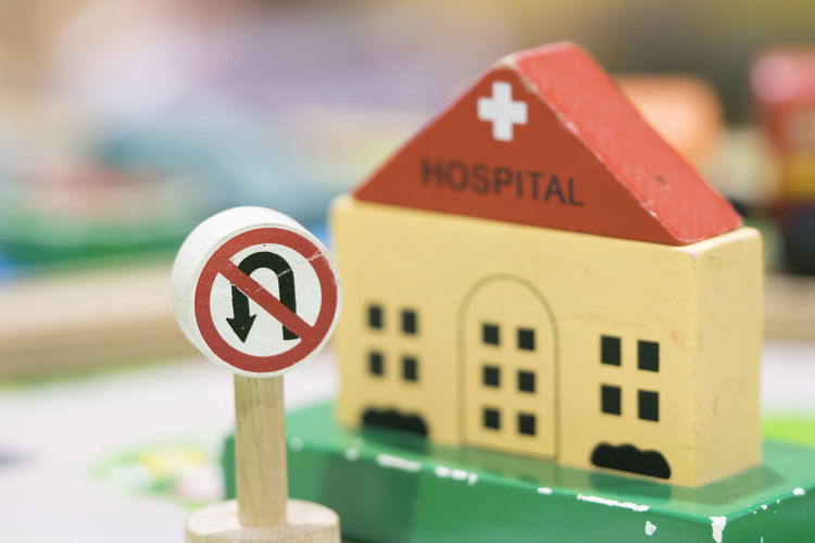 Hospital Wooden Toy Set and No return sign - Play set Educational toys for preschool indoor playground Communication Sign Focus On Foreground Close-up Road Sign No People Text Geometric Shape Shape Arrow Symbol Road Selective Focus Red Information Wood - Material Wooden Toys Wooden Toy Block Wooden Toy Train