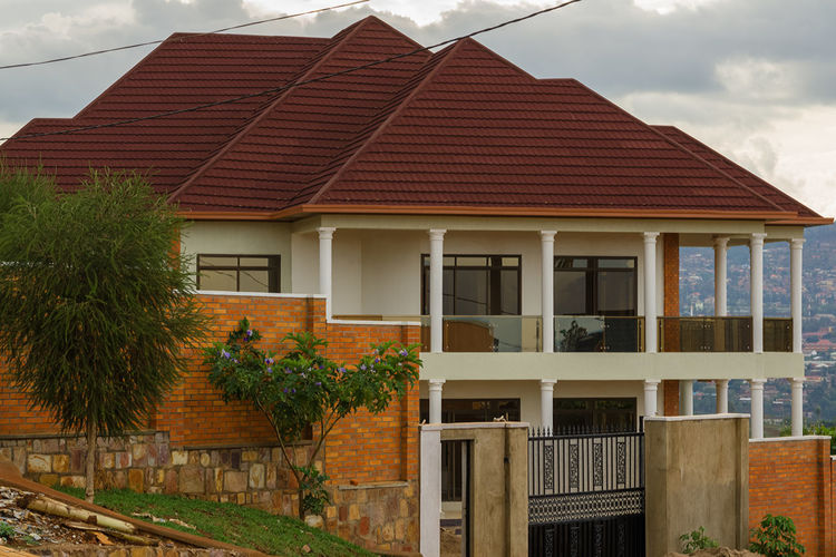 A new house in Gikondo Kigali Rwanda Africa Architecture Building Exterior Built Structure Cloud - Sky Day House Nature No People Outdoors Plant Roof Sky Tree