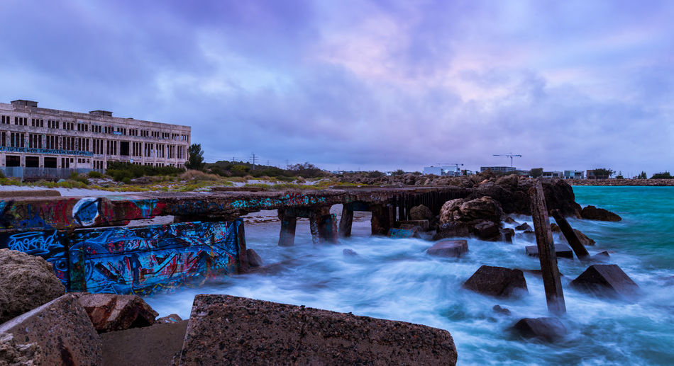 Adbandoned power station Graffiti Architecture Beauty In Nature Bridge - Man Made Structure Building Exterior Built Structure Cloud - Sky Day Horizon Over Water Long Exposure Motion Nature No People Outdoors Rock - Object Ruin Scenics Sea Sky Tranquility Water Wave