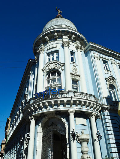 European Cities Novi Sad Serbia Balkans Europe Eastern Europe Outdoors Clear Blue Sky Architecture Facades Building Exterior Built Structure Low Angle View City Building Heritage Building Historical Place Painted Buildings The Past Sky Blue Tower No People Travel Destinations Architectural Column Ornate Dome