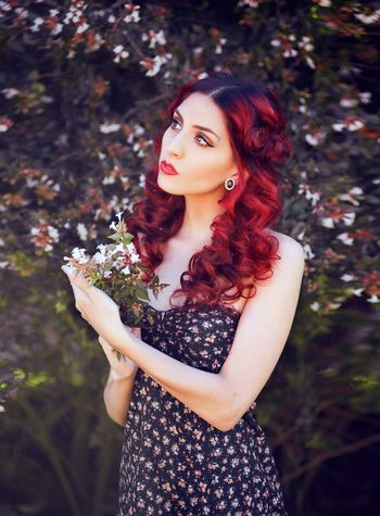 Hot red Curly Hair Hair Red One Person Beauty Young Adult Women Beautiful Woman Adult Young Women Standing Plant Portrait Looking Waist Up Nature Lifestyles Flower Three Quarter Length Hairstyle Outdoors