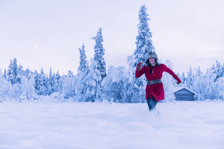 Full length of person standing on snow covered land