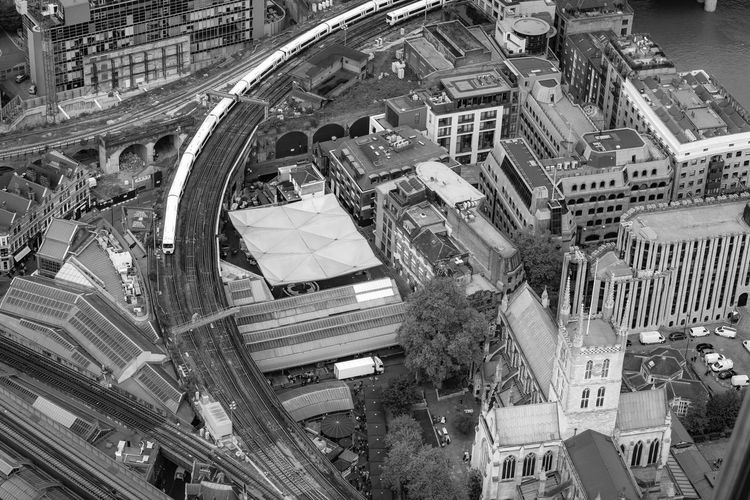 Architecture Built Structure Building Exterior City High Angle View Transportation Street Residential District Building Day Mode Of Transportation No People Outdoors Cityscape London Borough Market Lonodn Railway Curve Tracks Trains Capital City Church Historic Modern City Infrastructure Tree Planning Road City Life Aerial View Modern
