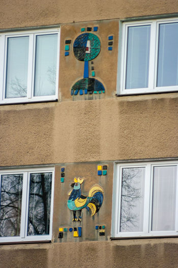 Low angle view of painting on glass window of building