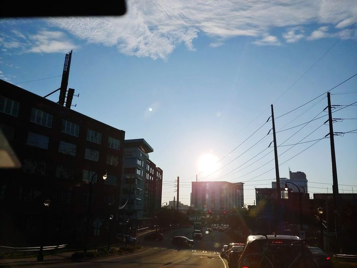 The Sun rises over My City. City Sunlight Metal Industry Sky Architecture Building Exterior Built Structure Cloud - Sky
