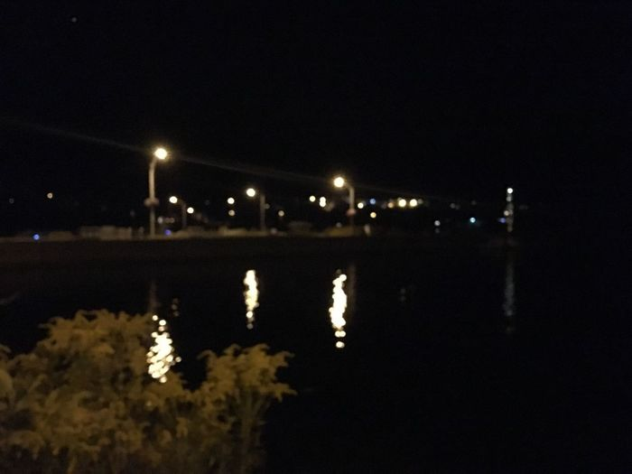 Out of focus lake at night. Night Illuminated Water Architecture Nature No People Reflection Street Light Lighting Equipment Outdoors Lake Light
