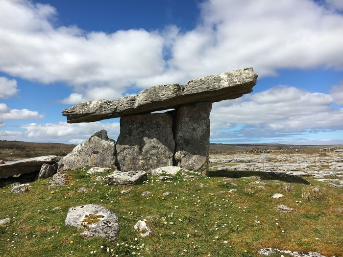 Stone structure on rock against sky