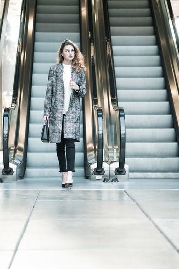 Full length of woman walking in bus