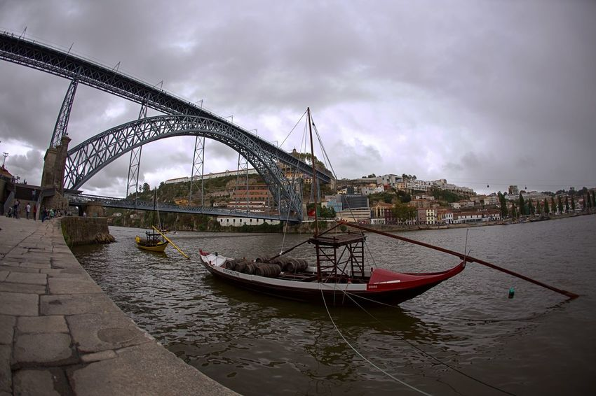 Architecture Boat Bridge Building Exterior Built Structure Canal Composition Connection Dark Engineering Famous Place Fish-eye Lens International Landmark Mode Of Transport Moored Nautical Vessel Outdoors Perspective Porto Portugal River Structure Transportation Water Waterfront