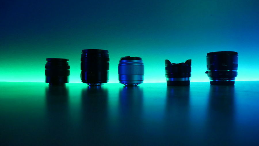 Lens Kit Arrangement Blue Blue Background Choice Close-up Colored Background Copy Space Glass - Material Group Of Objects Indoors  Lens Flare Lenses No People Reflection Science Selective Focus Side By Side Still Life Studio Shot Table Transparent Turquoise Colored Variation