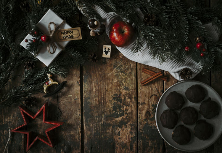 Holiday Celebration Christmas Decoration Indoors  Christmas Ornament Table Christmas Decoration Wood - Material No People Directly Above High Angle View Apple Gift Xmas