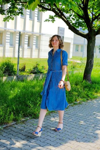 out of the blue One Person Plant Full Length Women Standing Fashion Urban Fashion Jungle Dress Nature Looking At Camera Hair Hairstyle Beautiful Woman Casual Clothing Portrait Day