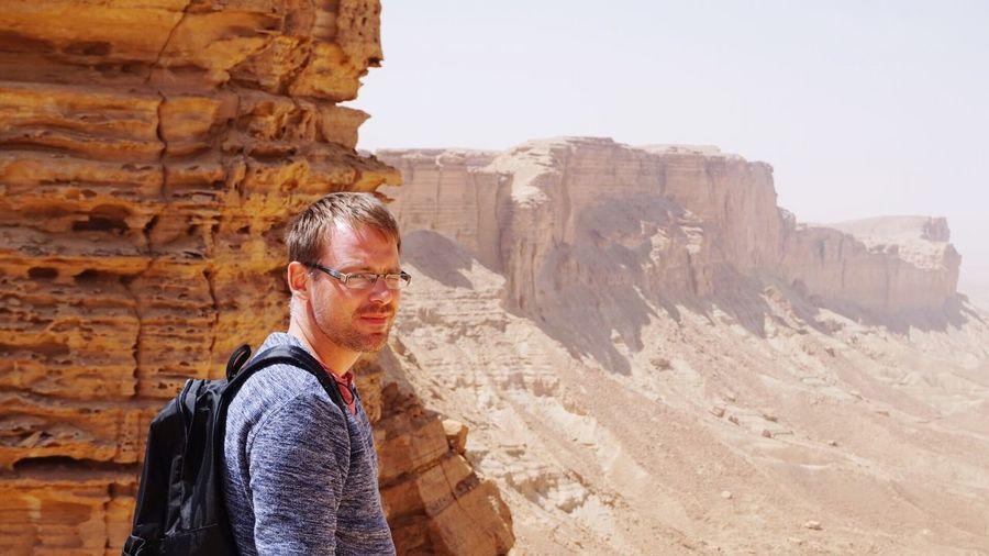 Portrait of a man against rocky landscape