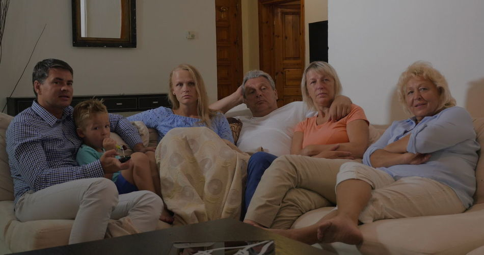 Group of people sitting at home