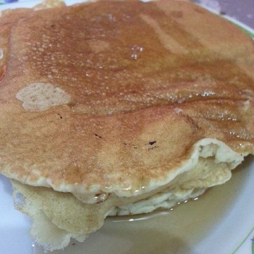 Uneven pancakes with maple syrup. BreakTheFast