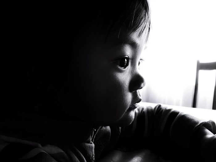 Profile view of girl looking away at home