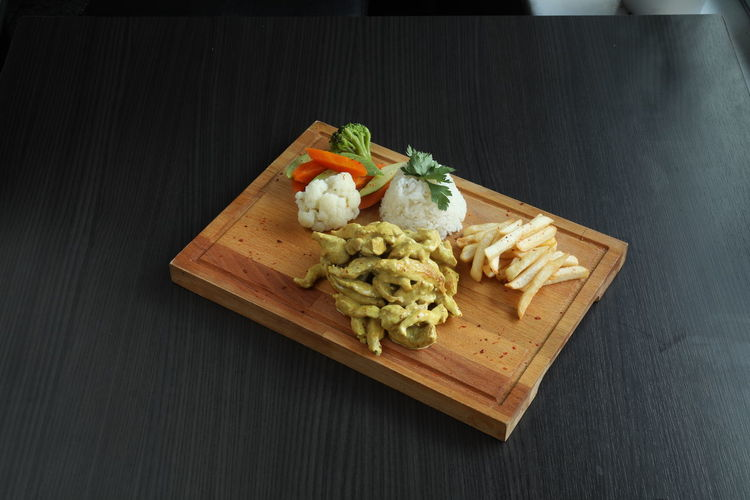 High angle view of chopped vegetables on cutting board