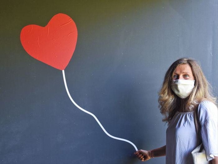 Portrait of woman with heart shape balloon