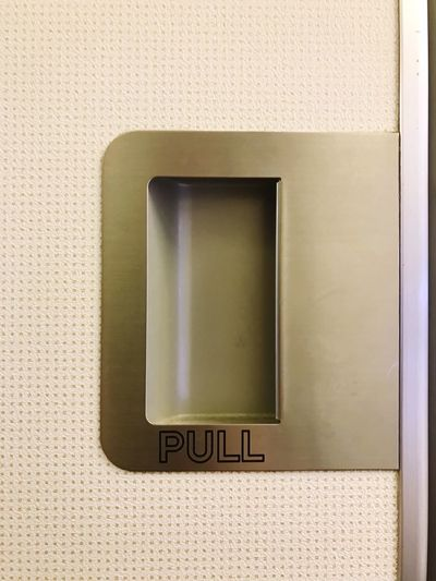 Close-up of pull text on door