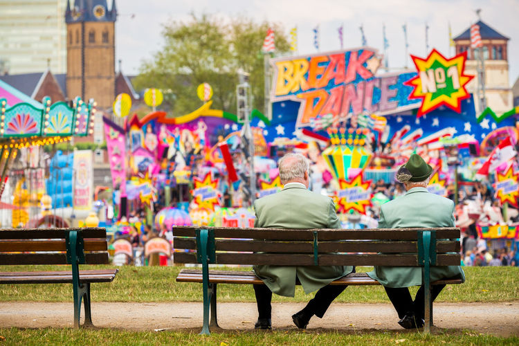Modern Stuff! Where are the good old times? – Funfair Düsseldorf, Germany City City Life Düsseldorf Focus On Foreground Funfair Kirmes Leisure Activity Lifestyles Multi Colored Rheinkirmes The Street Photographer - 2016 EyeEm Awards Colour Of Life TakeoverContrast Humanity Meets Technology
