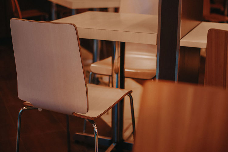 Empty chair and table in coffee shop