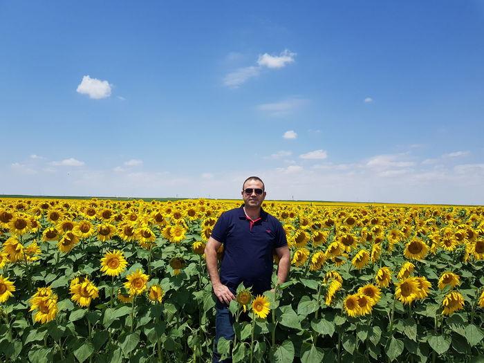 Full length of sunflower in field against sky