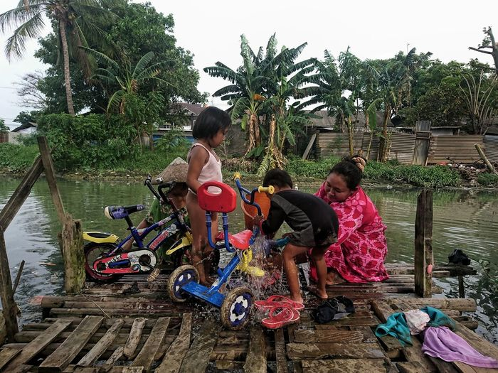 Citizen use the river water for daily activities River Sanitation Sanitary Riverflow Water Trashed Polution Polution On Water Peoples Lowangle Daily Life Daily Activities Children Group Of People Cikarang West Java  INDONESIA