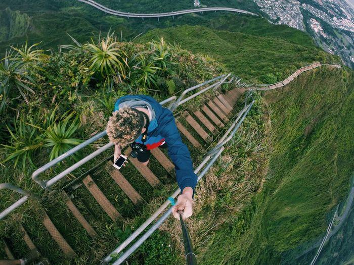 High Angle View Of Man On Haiku Stairs At Oahu