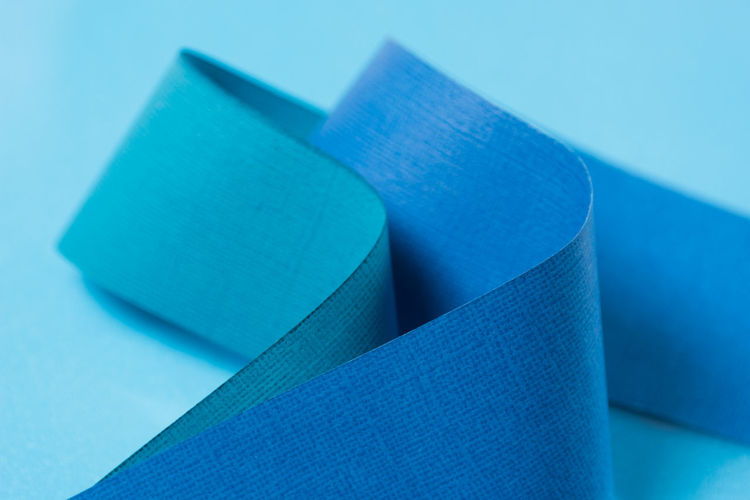 High angle view of blue paper on table