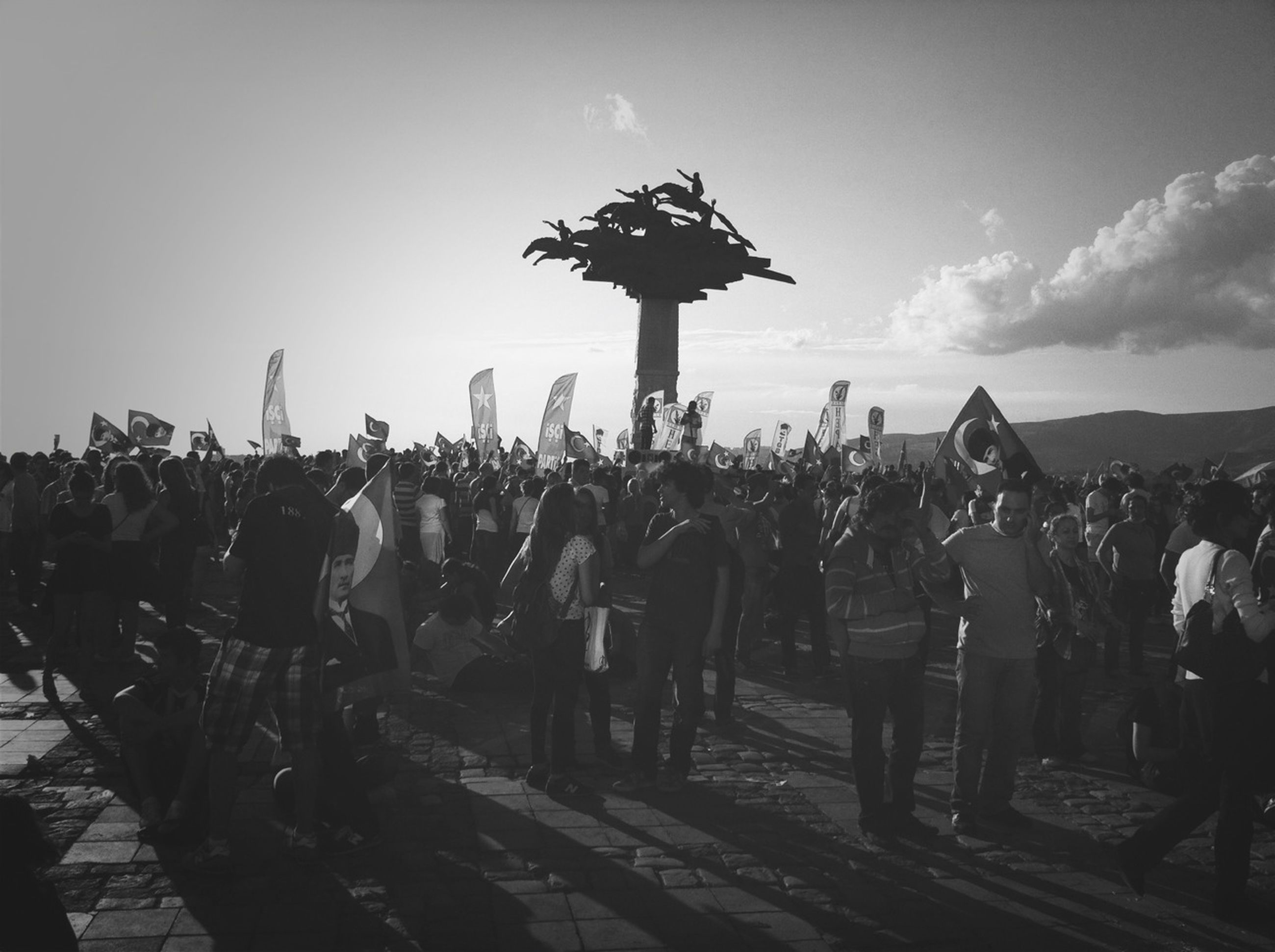 large group of people, sky, men, person, lifestyles, leisure activity, crowd, mixed age range, silhouette, standing, tourism, outdoors, travel destinations, travel, crowded, togetherness, tourist, landscape, cloud - sky