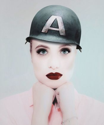 - A. - Check This Out A Helmet Only Women One Woman Only Adults Only Adult One Young Woman Only Portrait One Person Beauty Beautiful Woman Looking At Camera People Young Adult Headwear Headshot Human Body Part Women Beautiful People Studio Shot Young Women Close-up Visual Creativity