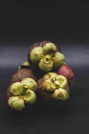 Close-up of apples on table against black background