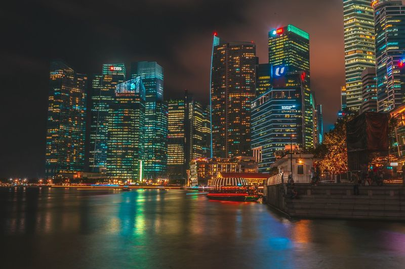 The bright city Building Exterior Architecture Built Structure Illuminated Night Building Office Building Exterior City Water Skyscraper Waterfront Tall - High Sky Urban Skyline Modern Travel Destinations Cityscape Residential District No People River
