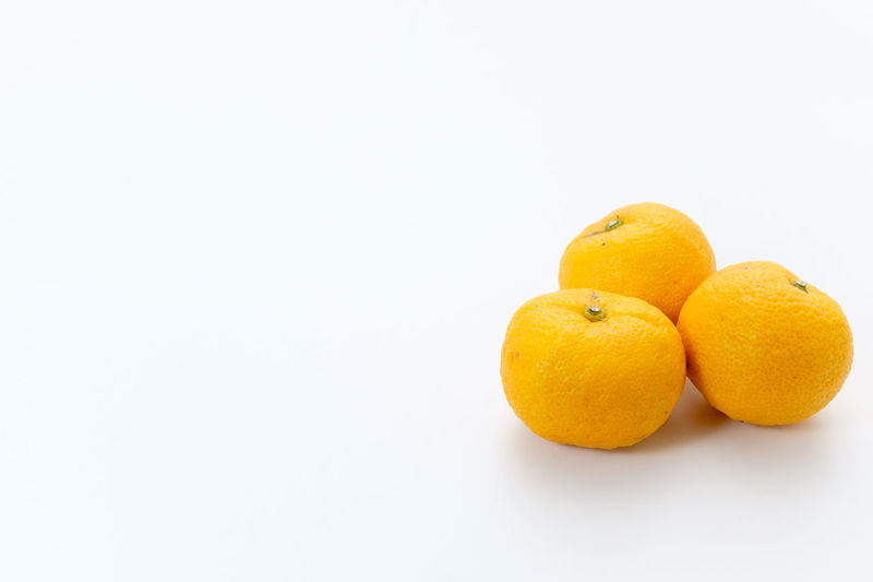 Citron, Japanese YUZU Fruit Citrus Fruit Healthy Eating Wellbeing Food Food And Drink Freshness Still Life Indoors  Close-up Orange Color Orange Orange - Fruit No People Yellow Citron Yuzu Studio Shot White Background Copy Space Group Of Objects Ripe Small Group Of Objects Vitamin C
