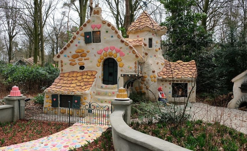 Attraction theme park the Efteling, Kaatsheuvel, the Netherlands. Built Structure Architecture Building Exterior Plant Building Tree Day No People Nature House Outdoors Residential District Religion Growth Belief Place Of Worship Multi Colored Wall Art And Craft Spirituality