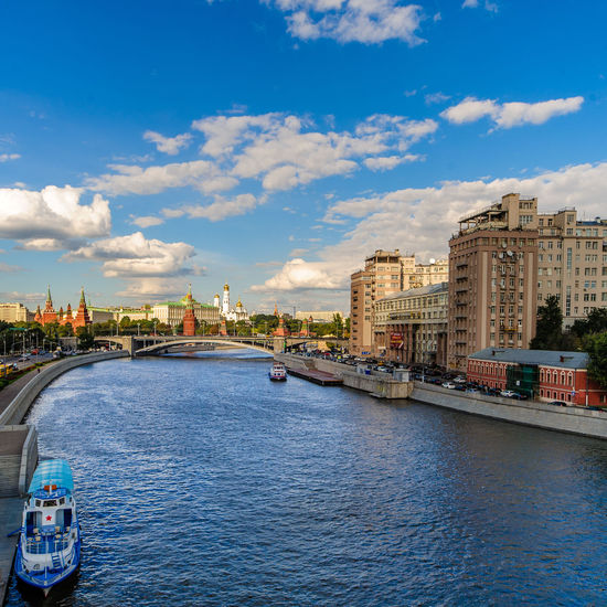A view of the Moscow river (with a river boat sporting a very Russian Red Star!) and the Moscow Kremlin from the bridge by the Christ the Saviour Cathedral. City Center Downtown Kremlin Moscow Moscow River Russia Travel Photography Architecture Bridge Bridge - Man Made Structure City Cityscape Cloud - Sky Day Destination Red Star River Boat Tourist Destination Tranquil Scene Travel Destinations Travelphotography Water