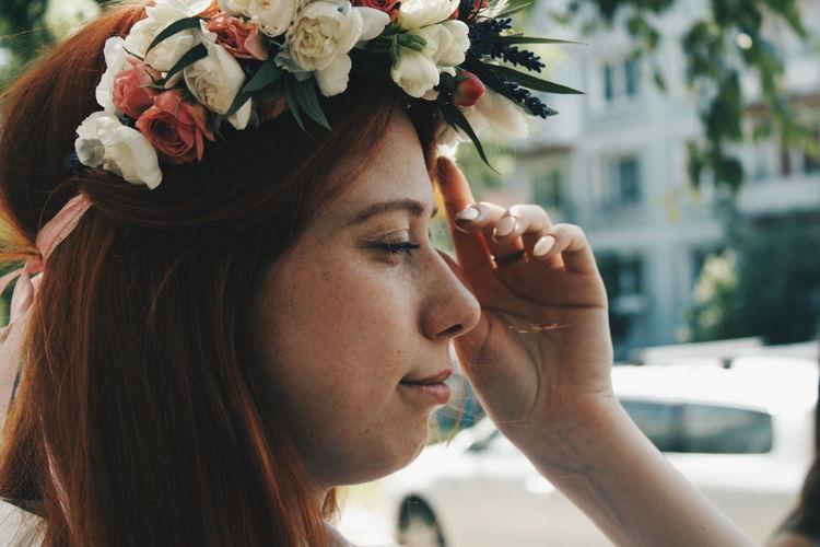 Close-up of young woman wearing tiara
