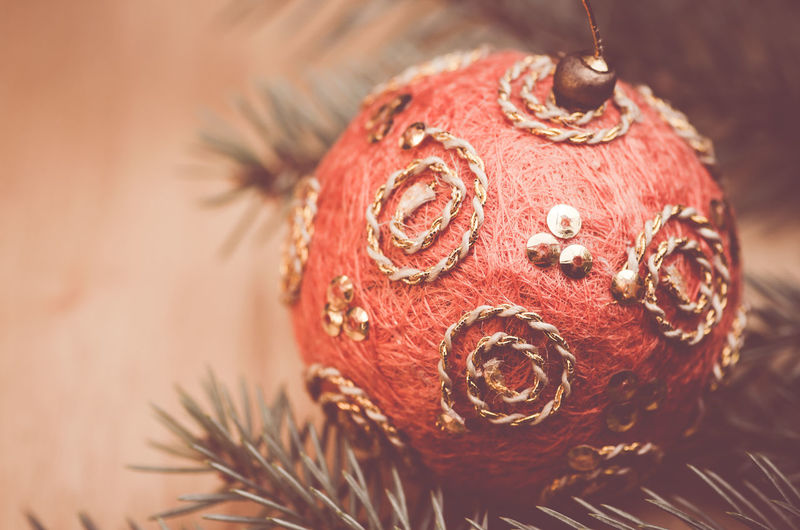 Christmas decorations - fir needle background Celebration Christmas Decorations Christmastime Close-up Cultures Decoration Detail Directly Above Elégance Fir Needles Focus On Foreground Fruit Ideas Indoors  Multi Colored Ornate Part Of Red Religion Still Life Studio Shot