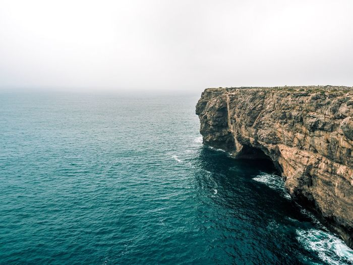 Cliffs in front of a misty ocean Rough Mist Ocean Coastline Landscape Coastline Cliff Sea Water Beauty In Nature Sky Scenics - Nature Rock Tranquil Scene Rock - Object Solid Nature Tranquility Horizon Over Water Horizon Day Rock Formation No People Copy Space Land Outdoors
